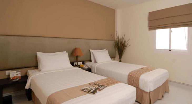 Hình ảnh phòng nghỉ 2 giường đơn tại nhà nghỉ Holiday Sài Gòn