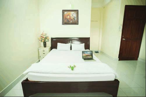 Thiết kế phòng ngủ sạch sẽ mà thoáng mát của khách sạn Dương Châu