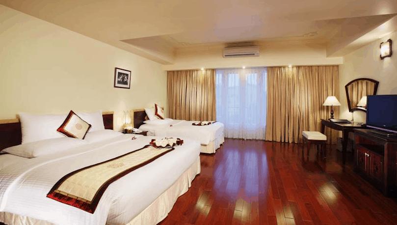 Phòng nghỉ 2 giường tại khách sạn Rex