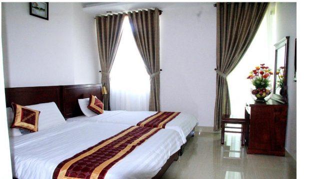 Căn phòng màu trắng trang nhã của khách sạn Minh Đăng (ảnh ST)