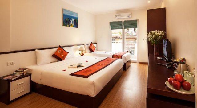 Phòng ngủ của khách sạn Rising Dragon Palace Hotel (ảnh ST)